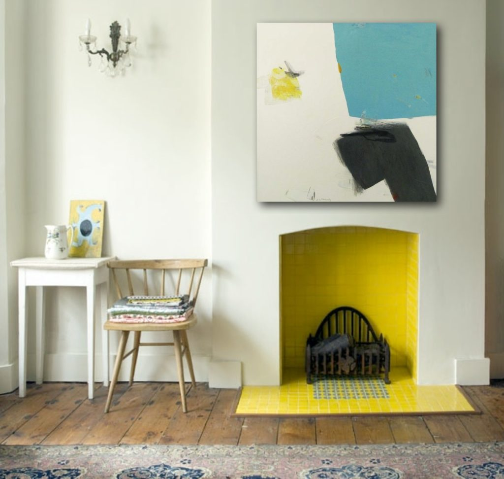 The Piece Plays Off Bright Yellow Fireplace And Blue Accents To Give E A Harmonious Blend Of Small Es
