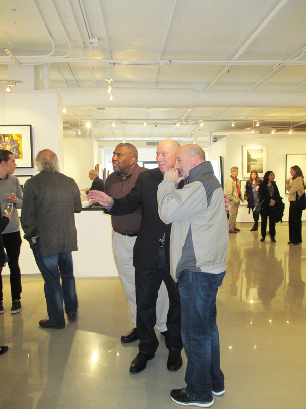 Charles Jacobs discusses his artwork with an interested guest