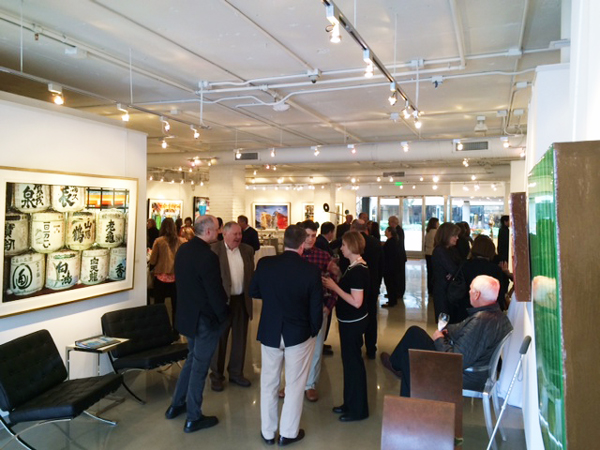 """Fans and friends gather to explore Jacobs' work, featured prominently in this photo is """"Sake Barrels"""""""