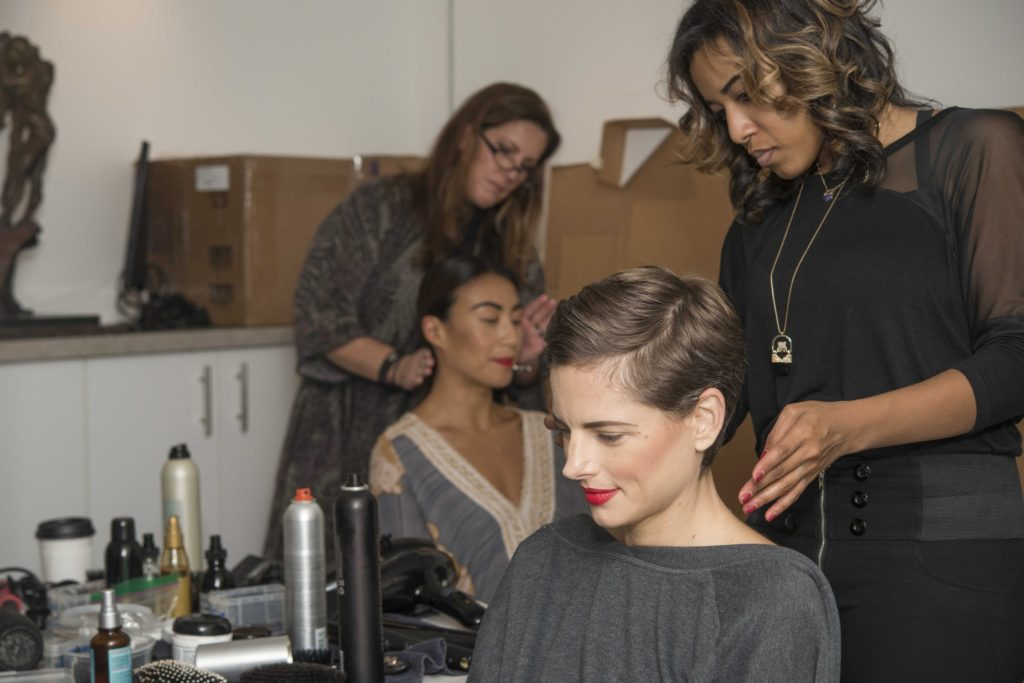 Some of the models having their hair and makeup done in preparation for the show.