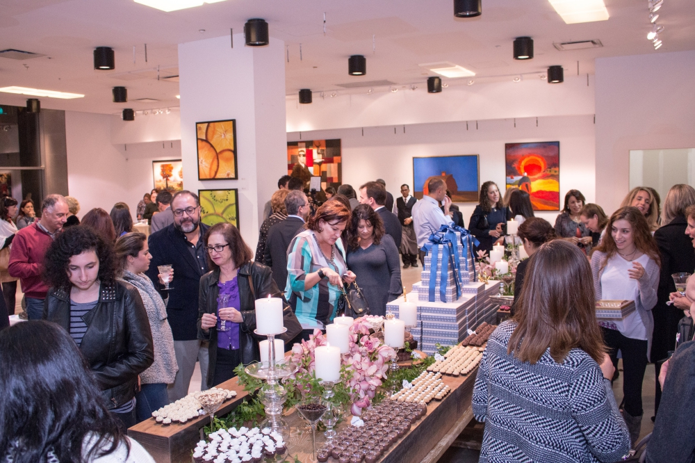 Mingling amongst delicious treats and a beautiful collection of artwork