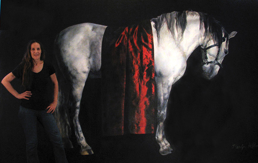 The artist in front of a work of equine portraiture