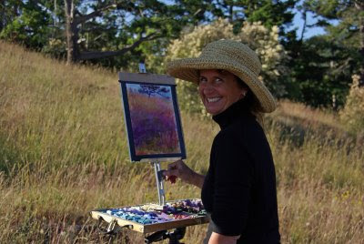 The artist in the field doing a study en plein air