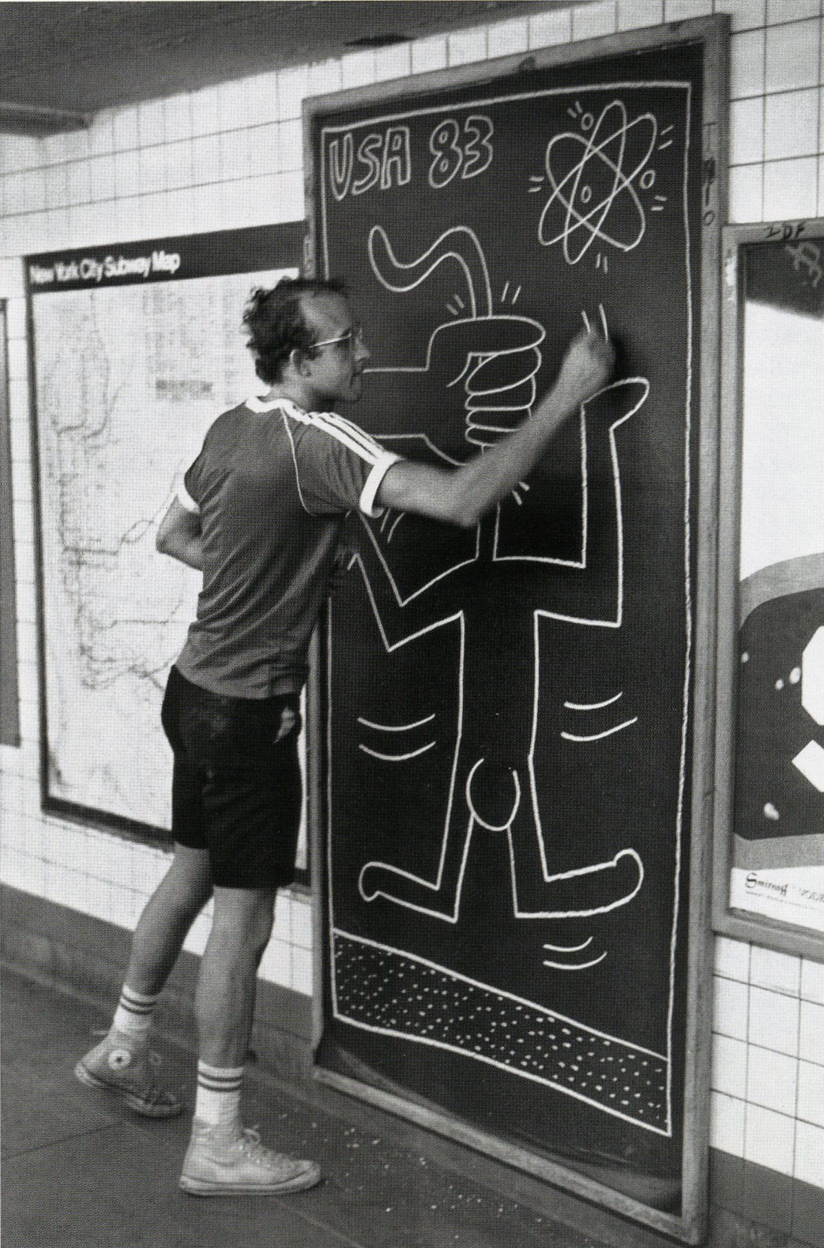 Haring drawing in the New York City subway system. (photo courtesy of the Keith Haring Foundation)